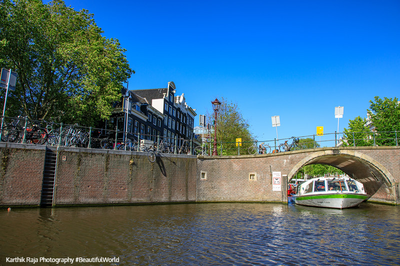 A boat through a canal, Amsterdam